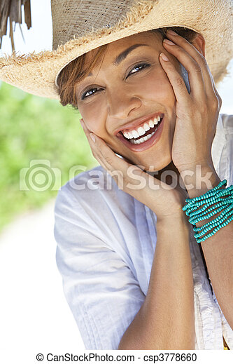 Beautiful Mixed Race Woman Laughing In Straw Coboy Hat - csp3778660