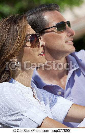 Attractive Thirties Couple In Sunshine Wearing Sunglasses - csp3778901
