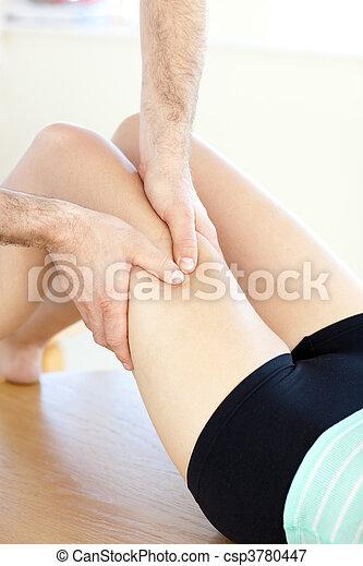 Close-up of a caucasian woman receiving a leg massage - csp3780447