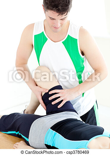 Assertive male physical therapist checking a woman\'s leg  - csp3780469