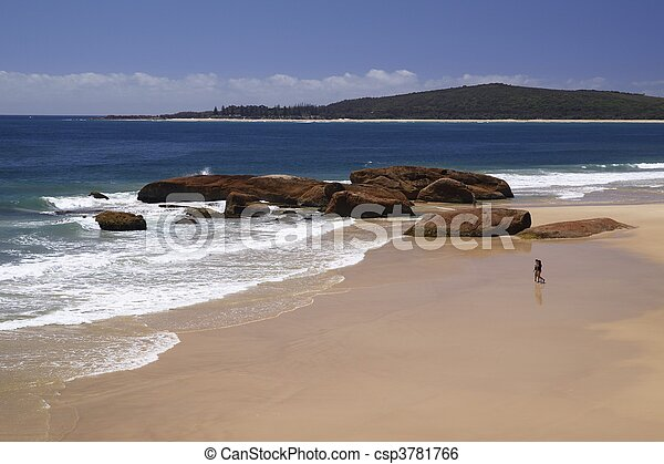 Australia, New South Wales , Booti Booti National Park, two promenaders walking towards the ocean on South West Rocks Beach; sandy beach with wide view of the Pacific ocean and coastline in the backgr - csp3781766