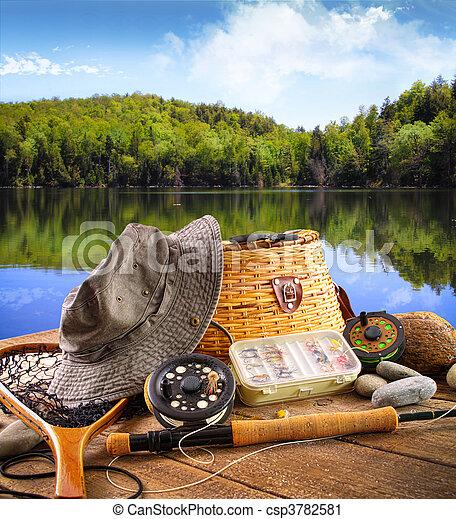 Fly fishing equipment  near a lake - csp3782581