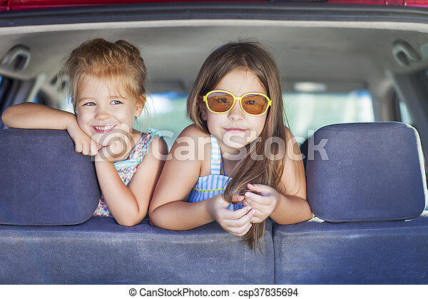 Happy kids in the car. Family on vacation. Summer holiday and car travel concept