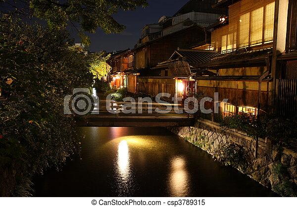 Illuminated Kyoto City historic district at night - csp3789315