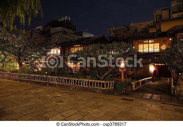 Illuminated Kyoto City historic district at night - csp3789317