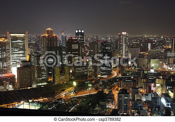 Illuminated Osaka City in Japan at night from high above - csp3789382