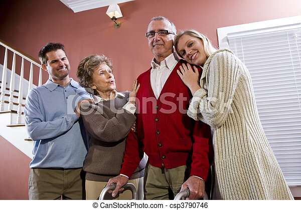 Elderly couple at home with adult children - csp3790746
