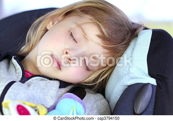little girl sleeping on children car safety seat - csp3794150