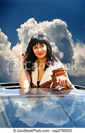 Beautiful brunette in the automobile - csp3795633