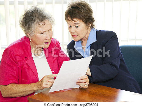 Senior Woman Reading Paperwork - csp3796094