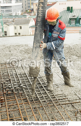 builder worker pouring concrete into form - csp3802517