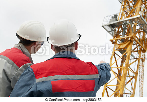 two builders at construction site - csp3803153