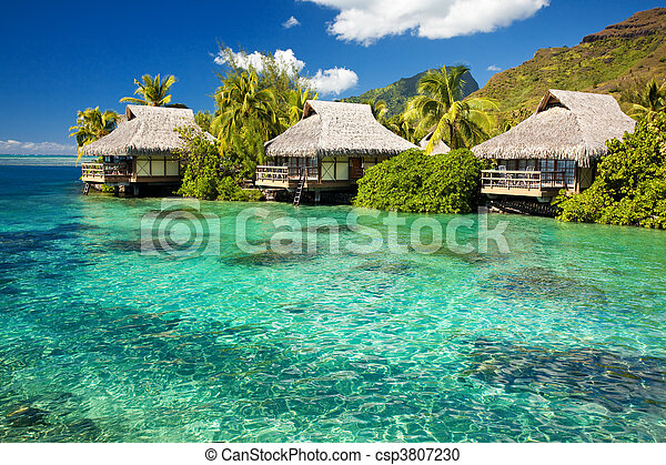 Over water bungalow with steps into amazing lagoon - csp3807230