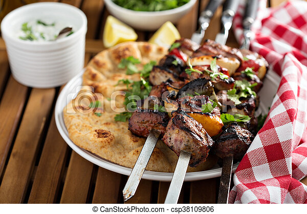 Lamb kebabs with flatbread and tzatziki sauce - csp38109806