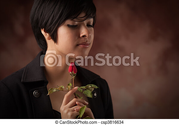 Pretty Multiethnic Young Adult Woman Portrait with Rose - csp3816634