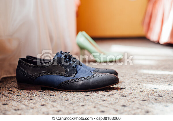 Set of groom clothes. Wedding rings, shoes, cufflinks and bow tie detalis fashion