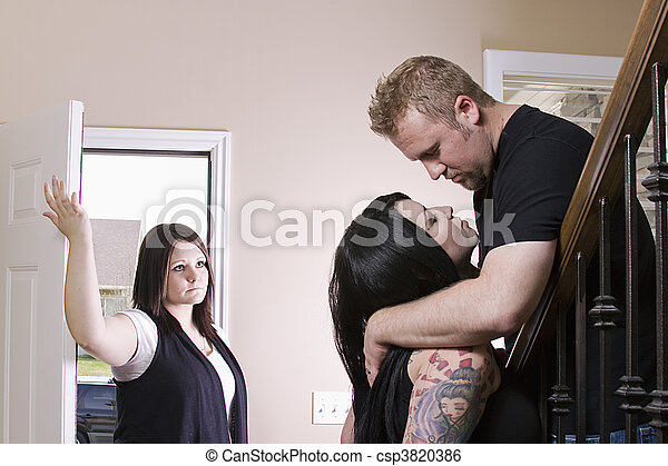 Wife Coming Home Finding Her Husband Cheating - csp3820386