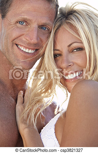 Sexy Attractive Man and Woman Couple Happy At the Beach - csp3821327