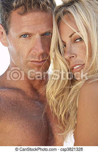 Sexy Attractive Man and Woman Couple At the Beach - csp3821328