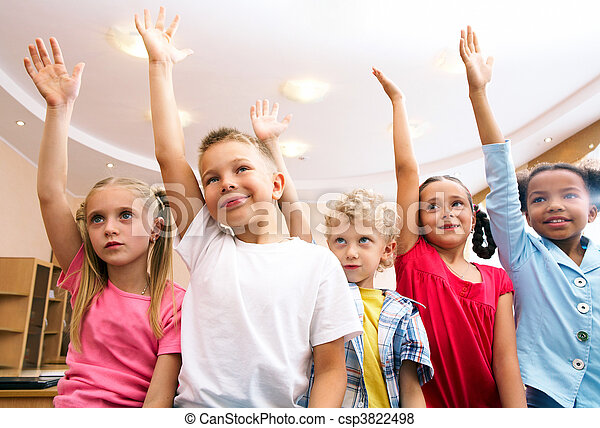 Image of pupils raising arms during the lesson