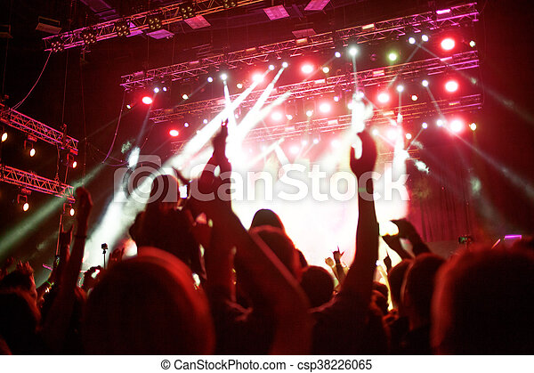 abstract soft background, the fans in the concert hall, hands in the air, hand fans during a concert