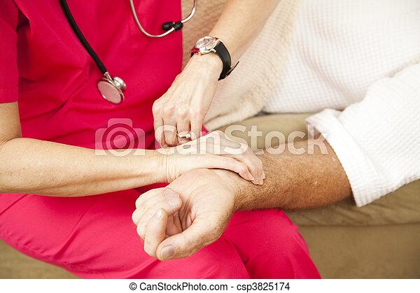 Home Health Nurse - Taking Pulse - csp3825174