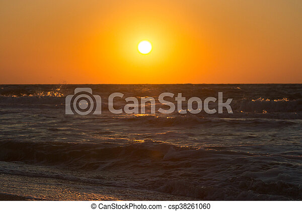 Stormy sunset at the sea. Wave and splash - csp38261060