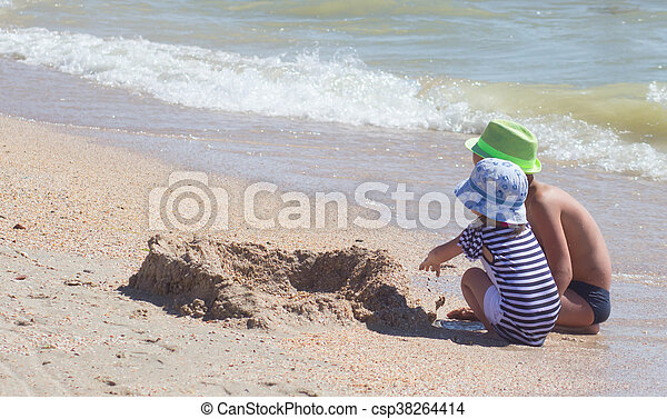 Happy little girl playing at beach - csp38264414