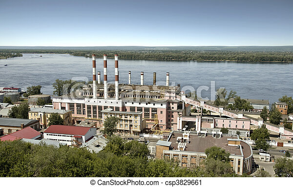 Building a power station in the city of Samara. On the bank of the Volga River. The building was built in 1930, the station was founded in 1904. Cityscape. Station building on the background of the Zh - csp3829661