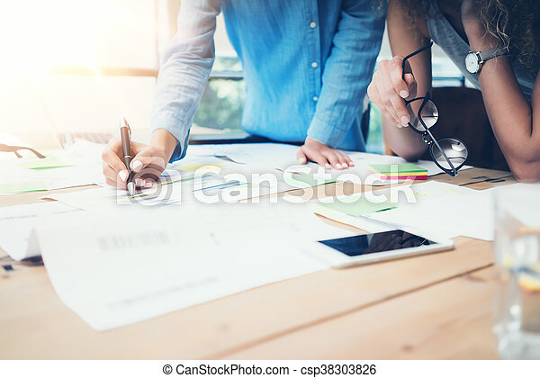 Coworkers Work Process Modern Office Loft.Account Managers Team Produce New Idea Project.Young Business Crew Working Startup.Smartphone Wood Table.Analyze Market Reports.Blurred,Film Effect.Horizontal