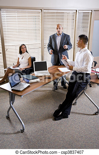 Manager meeting with office workers, directing - csp3837407