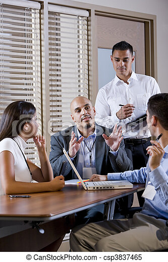 Manager meeting with office workers, directing - csp3837465