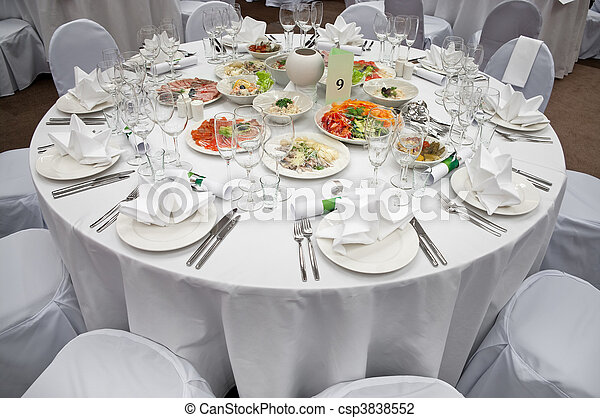 Wedding white reception place ready for guests. Elegant banquet tables prepared for a conference or a party. - csp3838552