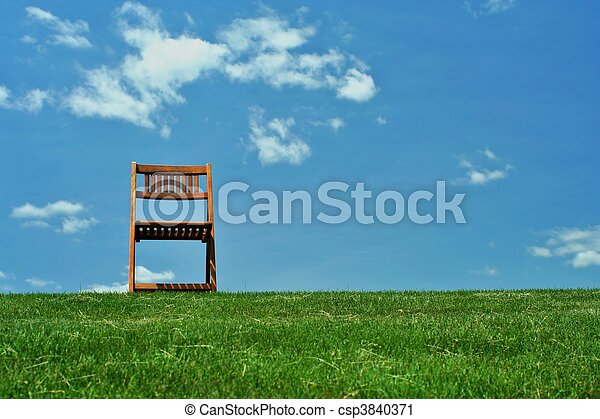 Wooden chair on a hilltop - csp3840371