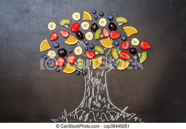 drawn with chalk tree with fruit and berries. toning. selective focus