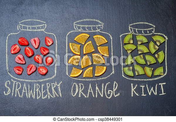 drawn with chalk jars with fruit and berries. toning. selective focus