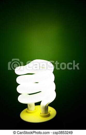 Compact Fluorescent efficient light bulb on green - csp3853249