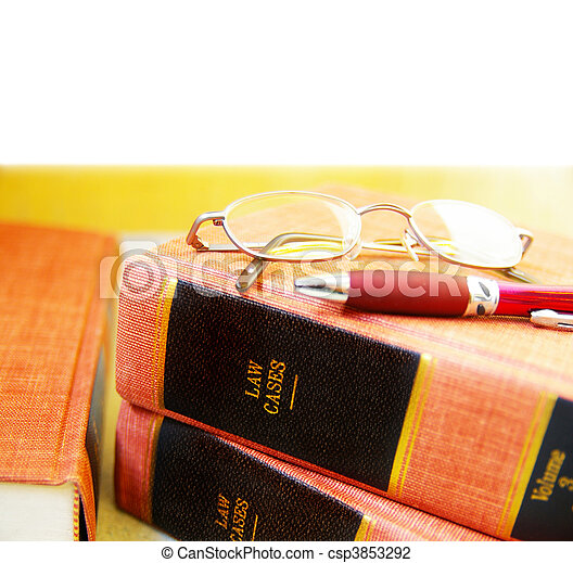 Closeup of law books, glasses and pen - csp3853292