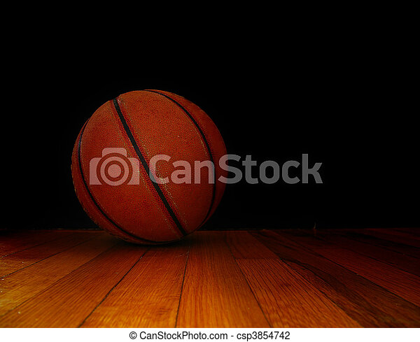 a basket ball on the court, over dark background - csp3854742