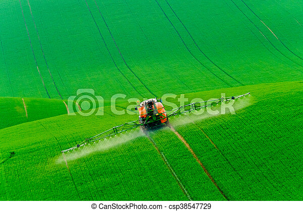 Tractor spraying the chemicals - csp38547729