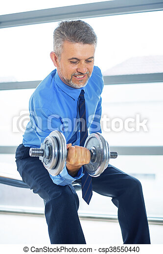 Businessman training in gym - csp38550440