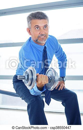 Businessman training in gym - csp38550447