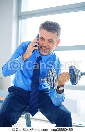 Businessman training in gym - csp38550469