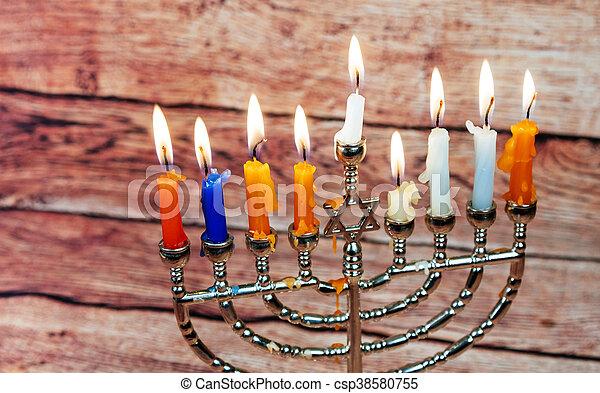 jewish holiday Hanukkah with menorah over wooden table Hanukkah candles