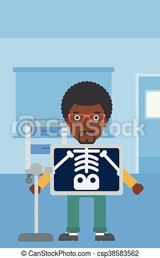 Patient during x ray procedure. - csp38583562