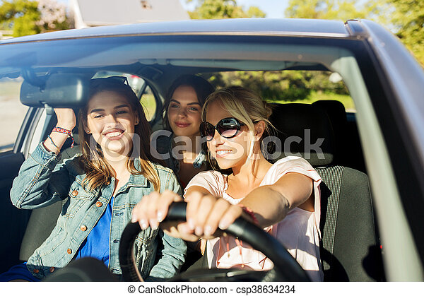 summer vacation, holidays, travel, road trip and people concept - happy teenage girls or young women driving in car