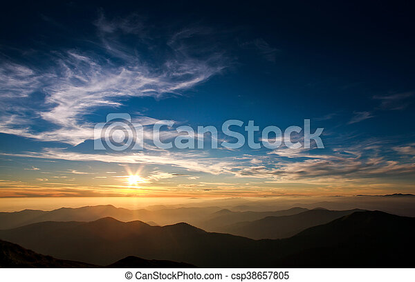 Magnificent sunset sky over silhouette of the mountains - csp38657805