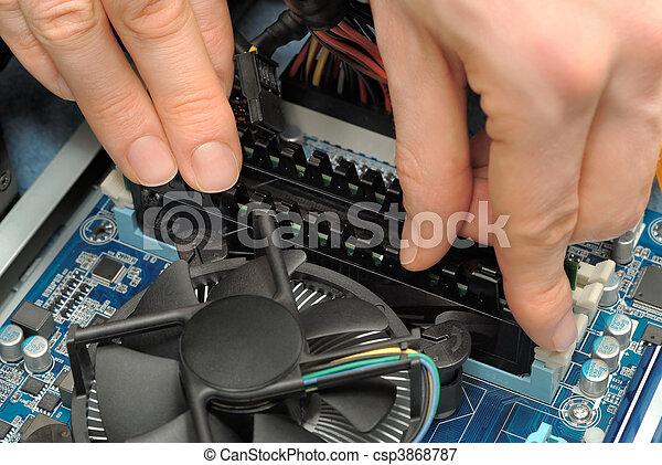 Hands installing computer parts - csp3868787