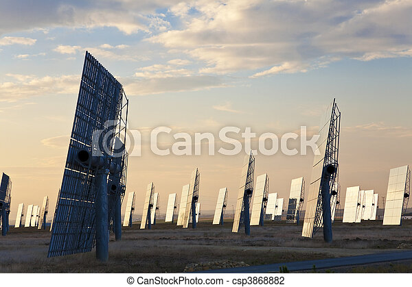 Green Energy Solar Mirror Panels at Sunset or Sunrise - csp3868882