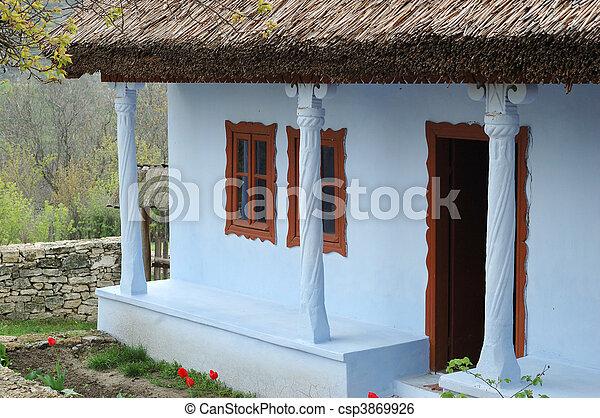 Old traditional moldavian house with roof covered with the dry rush - csp3869926